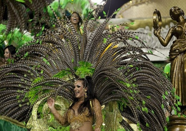 Brazilian carnival - dancers - The Carnival of Brazil (Portuguese: Carnaval, IPA: [kaʁnaˈvaw]) is an annual festival held forty-six days before 46 days of Lent, Roman Catholics and some other Christians traditionally abstained from the consumption of meat and poultry, hence the term